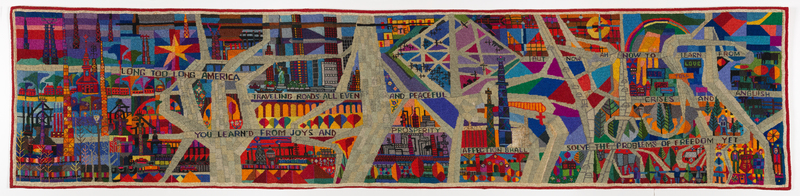 A textile consisting of an abstract cityscape in bright multicolor intersected by highways bearing inscriptions.