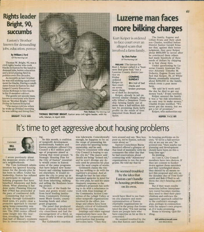 Newspaper clipping featuring a woman hugging her husband.