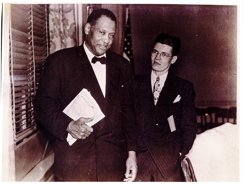 Two men in suits standing next to each other.
