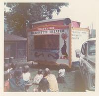 Several children watching a puppet show.