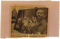 Newspaper clipping featuring a speaking man that stands in front of board with his artworks.