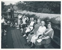 Several women sitting in a boat.