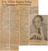 Newspaper clipping featuring a speaking man in a professional attire.