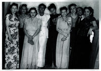 Several women in formal wear standing next to each other.