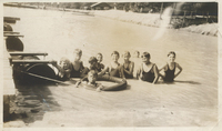 Several children standing above water.