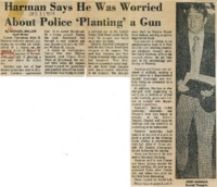 Newspaper clipping featuring a standing man in a black jacket and houndstooth pants with clipboard in his hands.