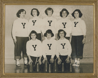 "Three girls kneeling while five girls stand behind them. They are all wearing white shirts with the letter ""Y"" on them."