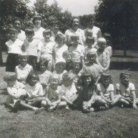 Women and children in a park.