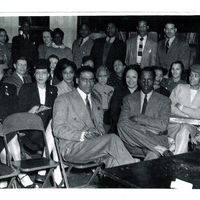 Several individuals in formal wear sitting.