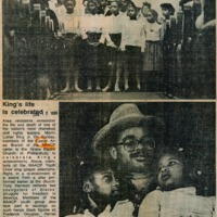 Newspaper clipping featuring a group of singing children in white dresses and a man in a hat and glasses hugging two girls.