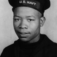 Headshot of a US Navy soldier wearing military uniform.