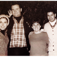 Two men and two women standing next to each other.